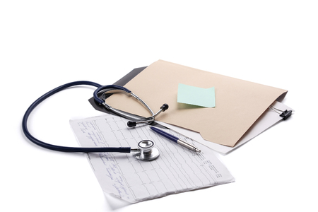 Close up of doctors medical stethoscope and patient medical information