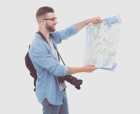 Young man holding map on white background