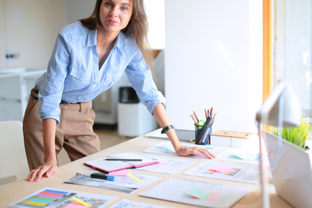 Young woman sitting at office table . Young woman. Stock Photo