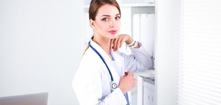 jalousie: Woman doctor is standing near window