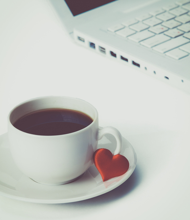 notepaper: Laptop or notebook with cup of coffee and heart on table
