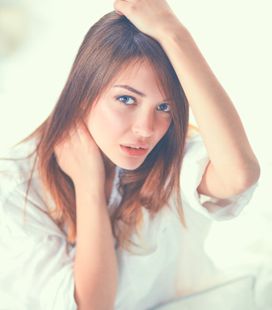 Portrait of beautiful woman on bed at bedroom Stock Photo