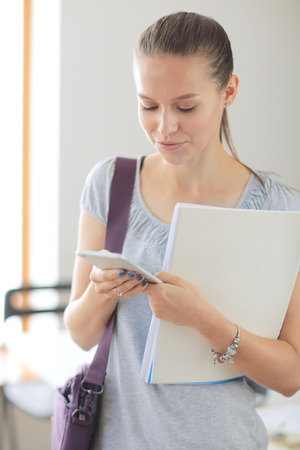 Woman use of mobile phone in university. Student woman Stock Photo