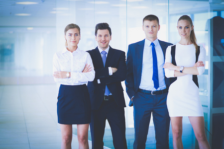 Happy business team showing thumbs up in office. Happy business team Фото со стока