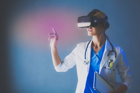 Female doctor wearing virtual reality glasses isolated on white background Фото со стока - 91201732
