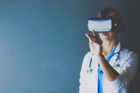Female doctor wearing virtual reality glasses isolated on white background
