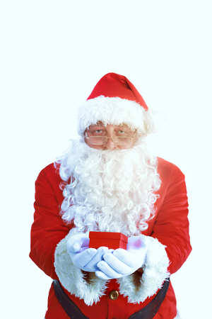 Santa Claus with Christmas Gift, isolated on white background Stock Photo