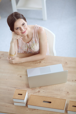 Business woman relaxing with her hands behind her head and sitting on a chair. business woman 免版税图像