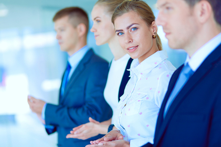 Smiling business people applauding a good presentation in the office . Smiling business people Stock Photo