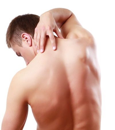 Young man standing back with pain in neck