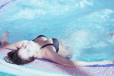 Young woman enjoying jacuzzi in a spa center. Young woman. jacuzzi Stok Fotoğraf