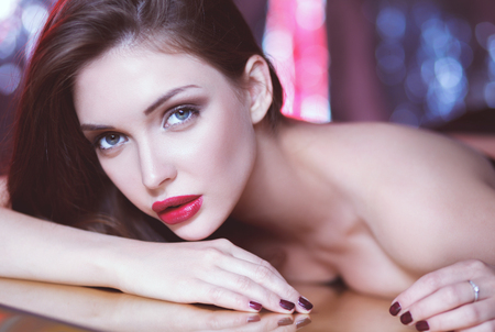 Portrait of beautiful girl with trendy makeup lying Stock Photo