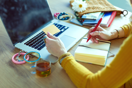 Young woman holding credit card and using laptop computer. Online shopping concept Stock Photo