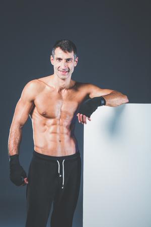 muscular man holding blank.