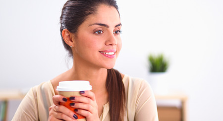 Beautiful  businesswoman enjoying coffee in bright office Stock Photo