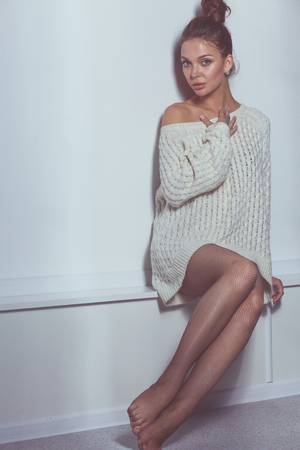 Portrait of a cute woman in sweater at home. Portrait of a cute woman