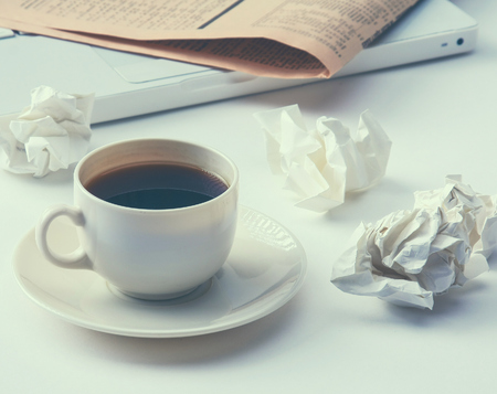 Working with crumpled paper and coffee cup on table background