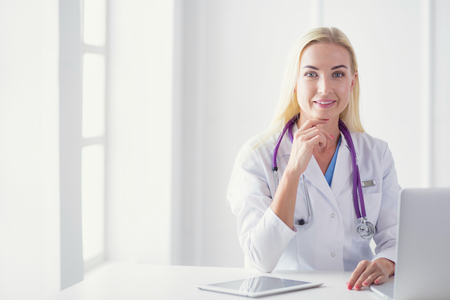 portrait of a young female doctor in a medical office Stock Photo
