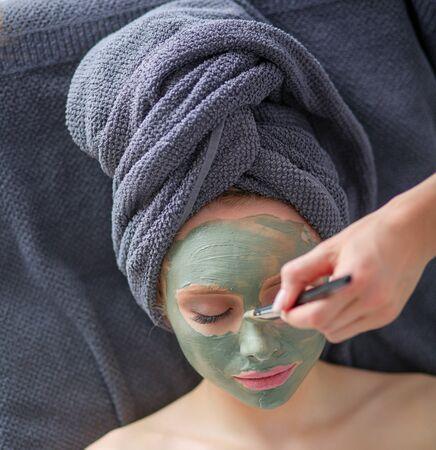 Beautiful woman having mask , lying on spa . Woman. Spa salon Stock Photo - 137326716