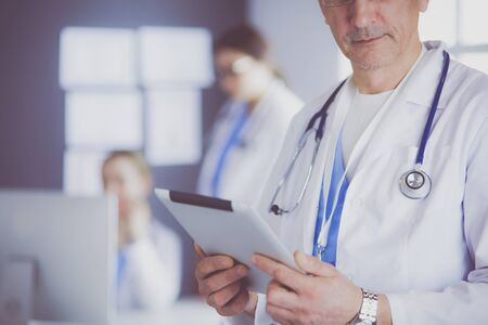 Medicine doctor working with modern tablet computer