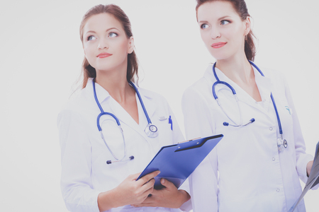Two woman nurse watching X Ray image, standing in hospital