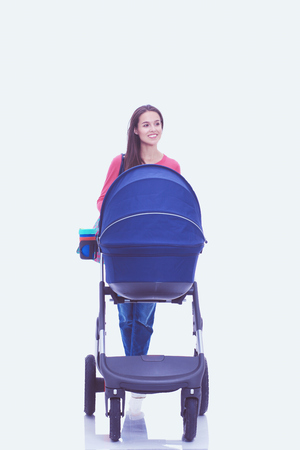 Full length portrait of a mother with a stroller, isolated on white background. Young mom 版權商用圖片