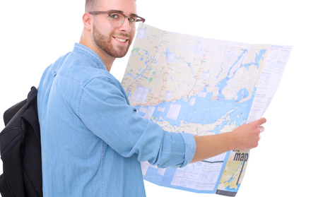 Young man holding at map on white background. Young man holding a map on a white background. A tourist on vacations. Looking for sights. Adventures seeker. Stock fotó