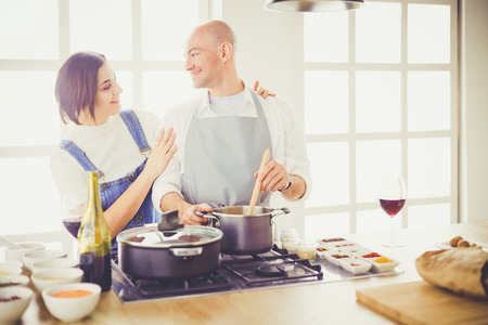 Couple cooking together in the kitchen at home 写真素材
