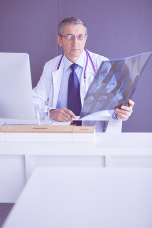 close up of male doctor holding x-ray or roentgen image