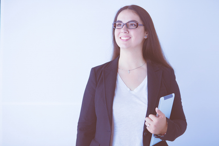 Portrait of smiling young business woman with digital tablet in her hands.