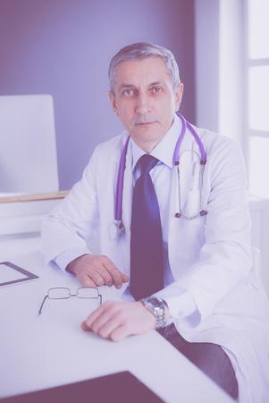 Portrait of a smiling doctor in his bright office Foto de archivo