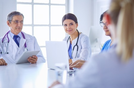 Doctors consulting with each other in a hospital conference room