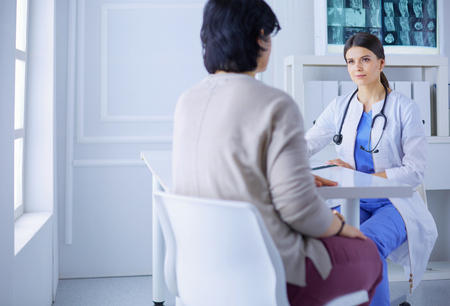 Medical consultation in a hospital. Doctor listening to a patients problems