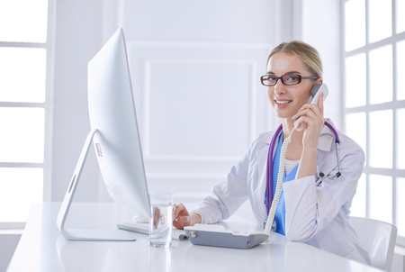 Female doctor having a phone call on medical office