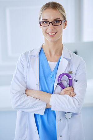 Young nurse with stethoscope. Nurse in green scrubs with stetoscope. Medical student in uniform