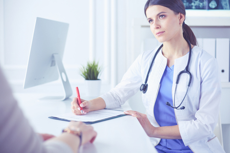 A serious female doctor examining a patients lymph nodes