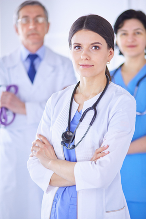 Group of doctors and nurses standing in a hospital room Stock Photo