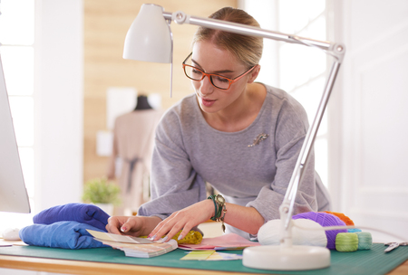 Fashion designer woman working in the studio Stock Photo