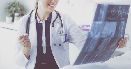 Young attractive female doctor looking at x-ray image 版權商用圖片