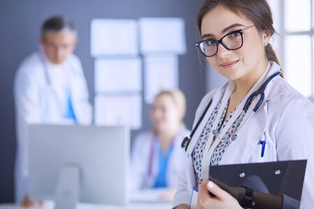 Woman doctor standing with stethoscope at hospital