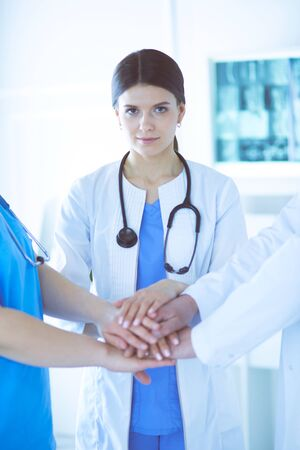 Group of doctors putting their hands together. Close-up Stock Photo