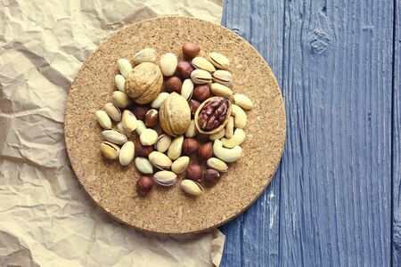 Nuts decorated in a plate on a wooden desk. 版權商用圖片