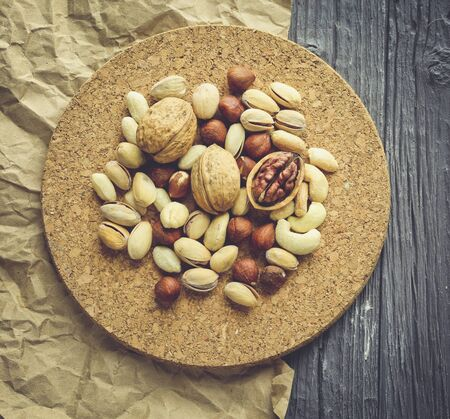 Nuts decorated in a plate on a wooden desk