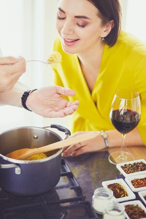 Couple cooking together in the kitchen at home Stock Photo