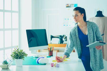 Portrait of Fashion designer working in her studio