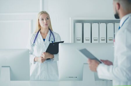 Woman doctor standing with folder at hospital Zdjęcie Seryjne