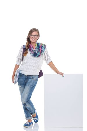 Beautiful student woman pointing on blank board. Student 스톡 콘텐츠