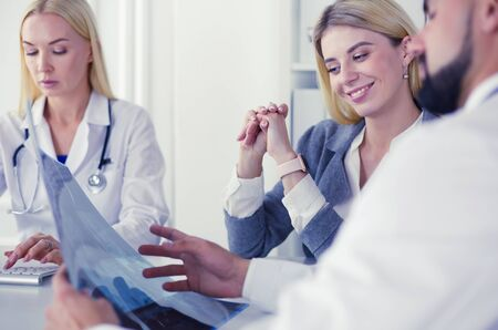Doctor woman shows the patient chest x-ray