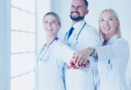 Doctors and nurses coordinate hands. Concept Teamwork in hospital for success work and trust in team Banco de Imagens - 128427499
