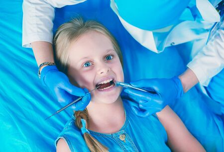 Little girl sitting in the dentists office. Stock Photo - 129461507